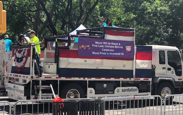 Sign reads Mayor Bill de Blasio and First Lady Charlene McCray Celebrate World Pride & Stonewall 50.