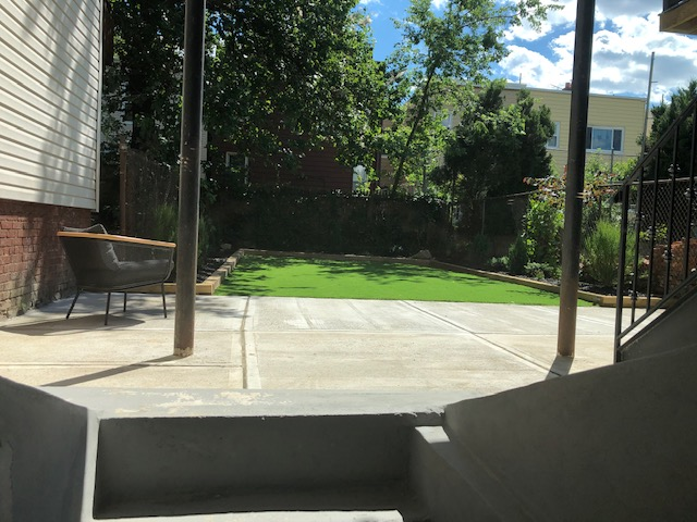 A backyard, although that grass is fake