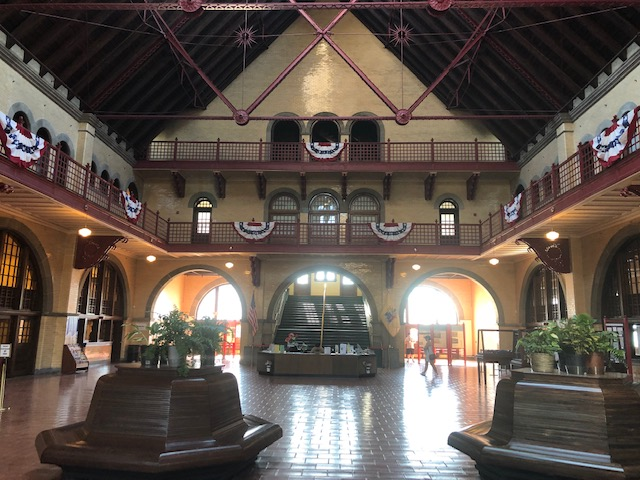 Inside the train station. Big room open to the second level with a balcony along the perimeter