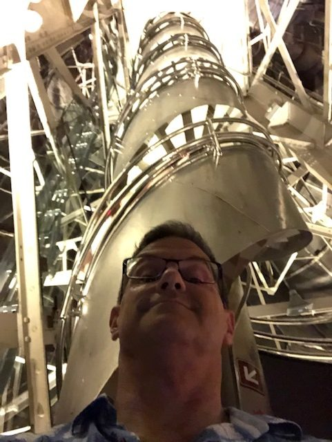 A selfie with the steel spiral staircase going up over my head
