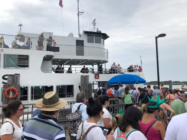 Hoards of people getting on the ferry