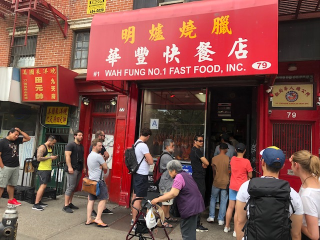 Sign above restaurant: #1 Wah Fung No. 1 Fast Food, Inc