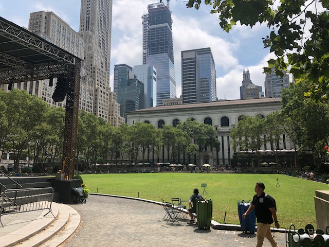 Lawn of Bryant Park, with the end of a stage to the left