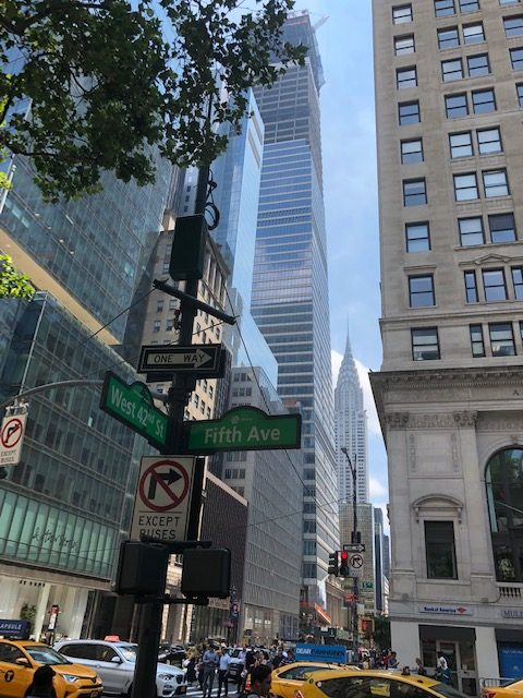 Intersection of Fifth Ave and 42nd St, with the Chrysler building in the background