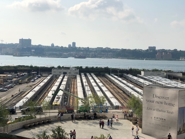 Looking out past trains into the Hudson River