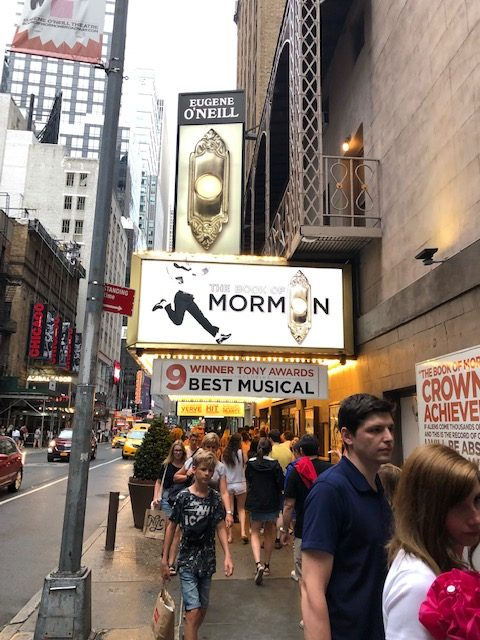 Book of Mormon marquee from the sidewalk