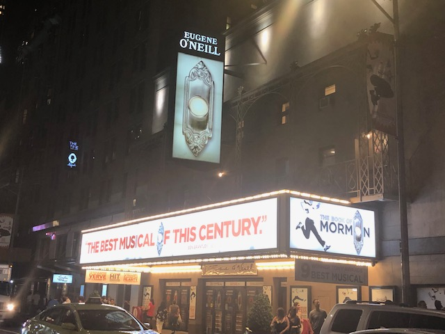 """Book of Mormon marquee claiming """"The Best Musical of the Century"""" on the long side of it, taken from across the street"""