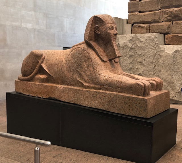 A small sphinx, about 12 feet long, maybe as high including the base