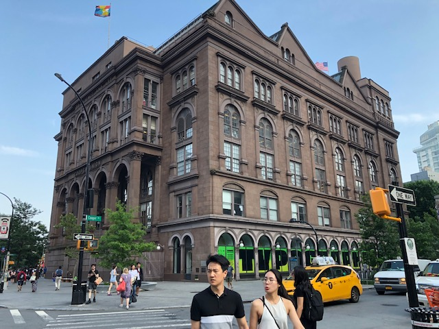 A 5 (or more) story Italian brownstone, large, by itselt on a square