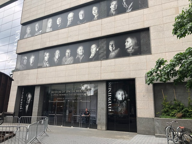 Entrance to the museum - two rows of black and white photos, each maybe 2x3 feet, above the doors, 9 per row