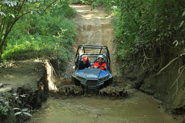 Driving an ATV through a huge puddle of water