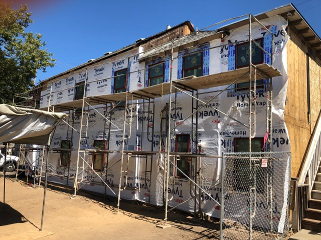 south side papered after plywood, awaiting new siding, all new windows in