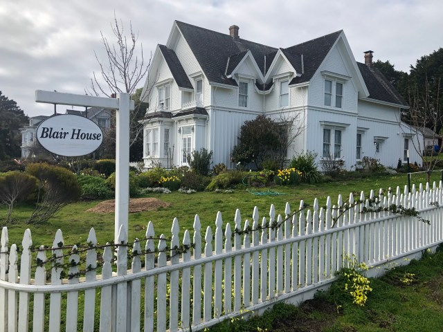 Blair House, a bed and breakfast - white house with lots of gabled, white picket fence in the foreground