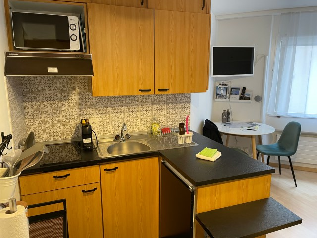 Room showing the kitchen area