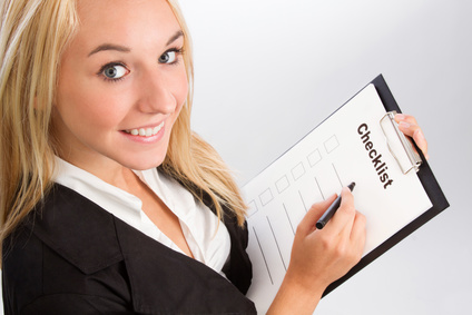 Young woman with checklist over shoulder shot