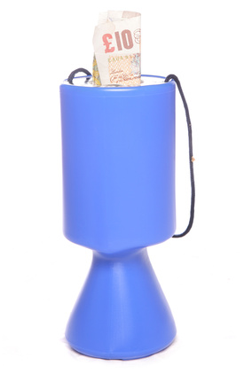 charity collection tin with money