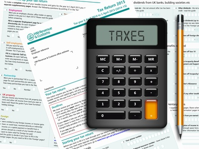 SA100 tax return form with calculator and pencil lying on table