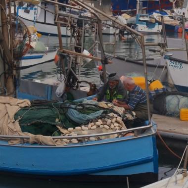Fishermen mending their nets