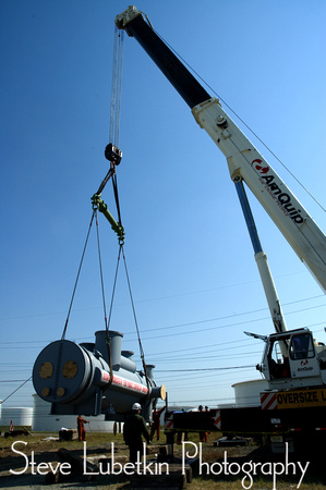 Perry Products 115,000-pound heat exchanger is lifted off flatbed at refinery