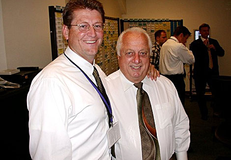 Future Dodgers GM Logan White stands with Dodgers legend Tommy Lasorda.