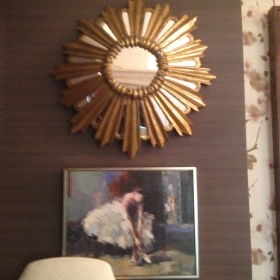 Love the juxtaposition of this classic work of art and modernly styled mirror.
