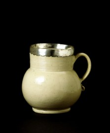 """Stoneware mug with silver collar by John Dwight, 1682. V&A The stoneware mugs of this shape were termed 'gorges', meaning narrow-necked vessels"""" V&A"""