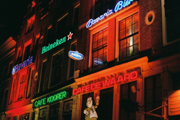 Analogue photo of Neon bar signs in Leidseplein at night