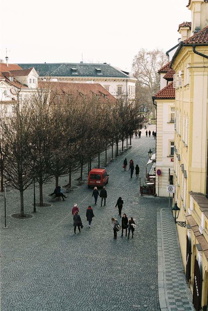 analogue photo of the intricate pattern of cobbles on the street under Charles Bridge, Prague