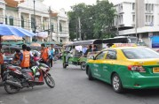 Three forms of tranport: motorcycle, taxi and tuk tuk