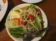 Som Tum or green papaya salad. For travelers a good rule of thumb is to always remember to order dishes and mention for less spicy. But never order a spicy dish as not spicy. This just completely ruins the overall taste.