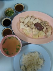 Khao Mun Gai or chicken with rice or Thai version of Hainanese chicken and rice or just plain good food. This dish is located in an area of Chiang Mai known for this specialty dish. There's several restaurants lining this block that serves this.