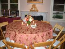 Guests sat at tables in a cozy fireplace room.