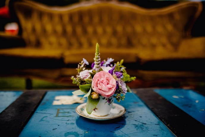 details from the vineyard wedding in kent, flowers in tea cup on table, vintage couch