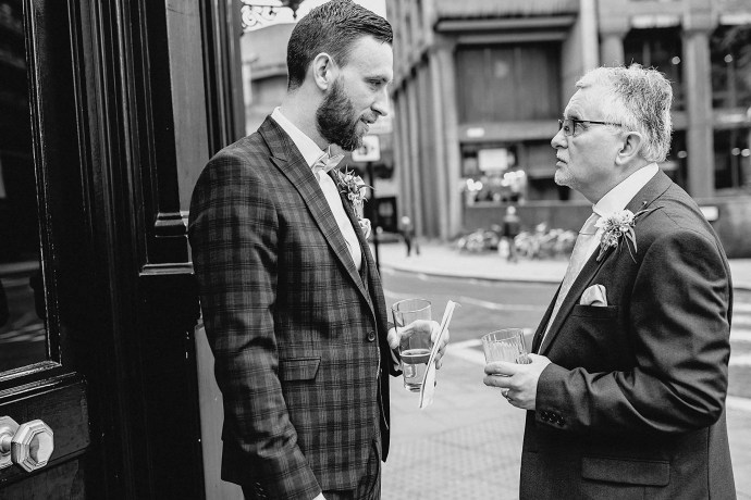 groom with his dad, father of the groom, suits, buttonholes, flowers