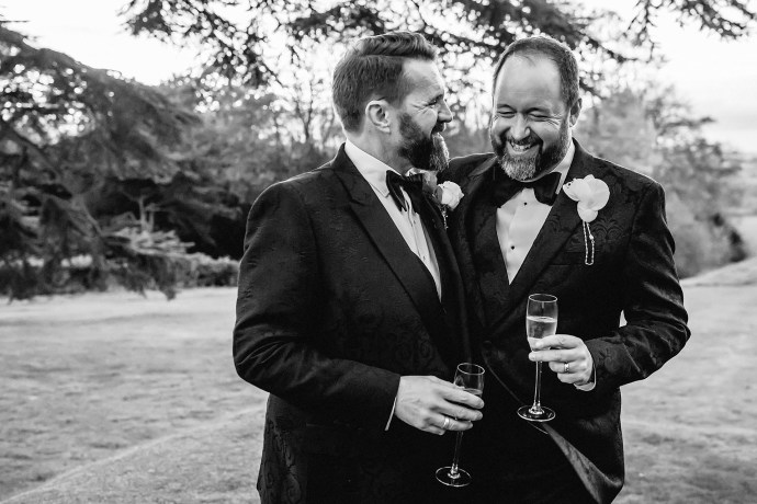 groom and groom portrait, champagne