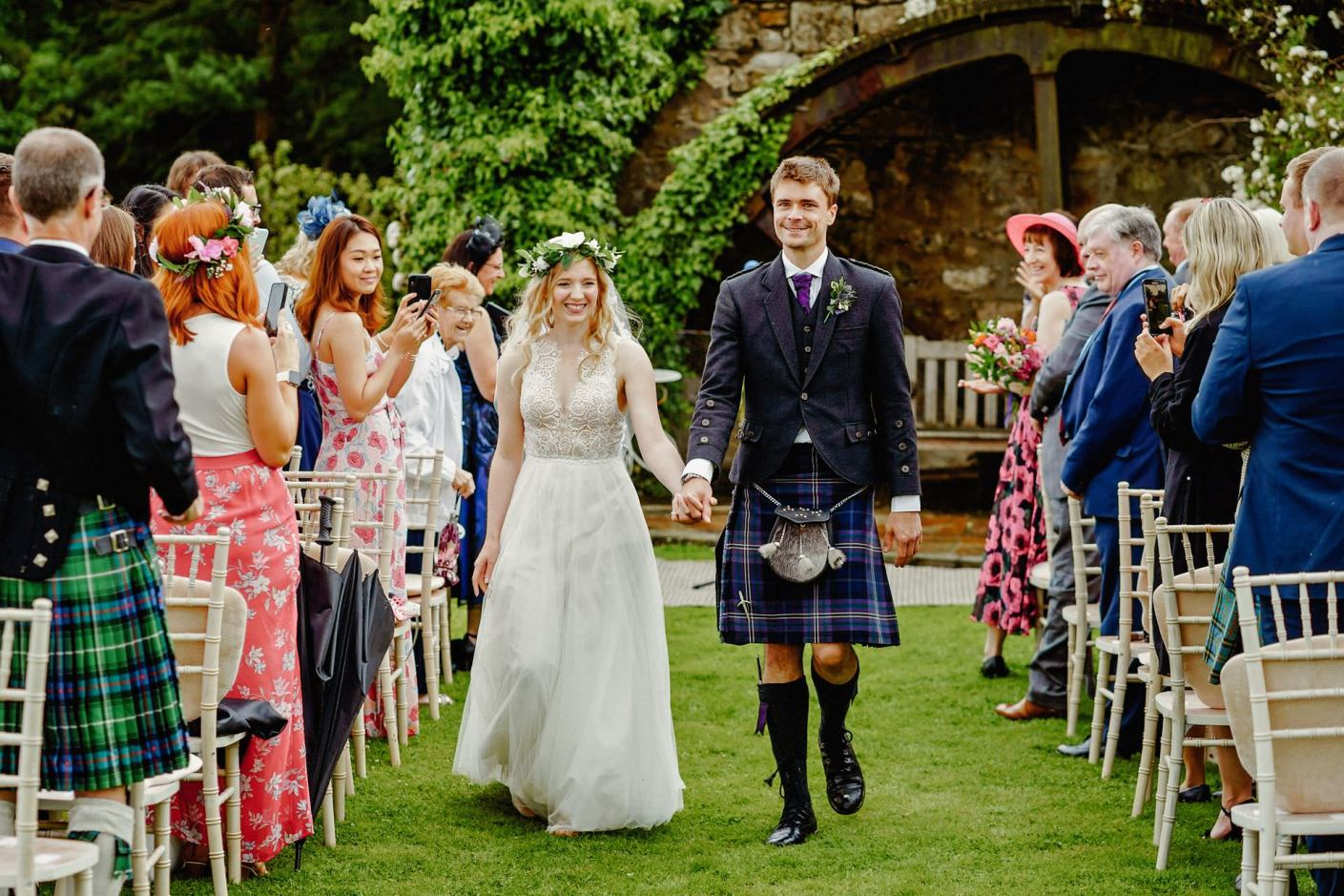recessional, leaving the wedding as man and wife down the aisle