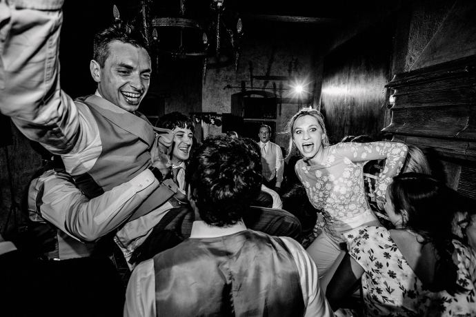 lifting bride and groom