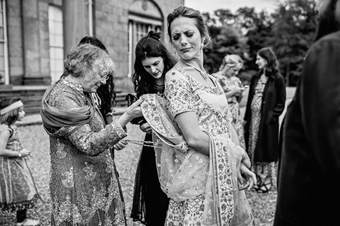 mother of the bride fixing dress