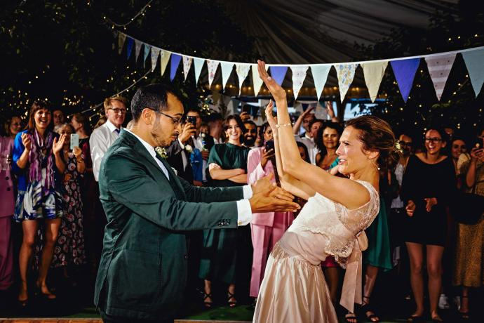 crazy first dance in marquee next to bunting