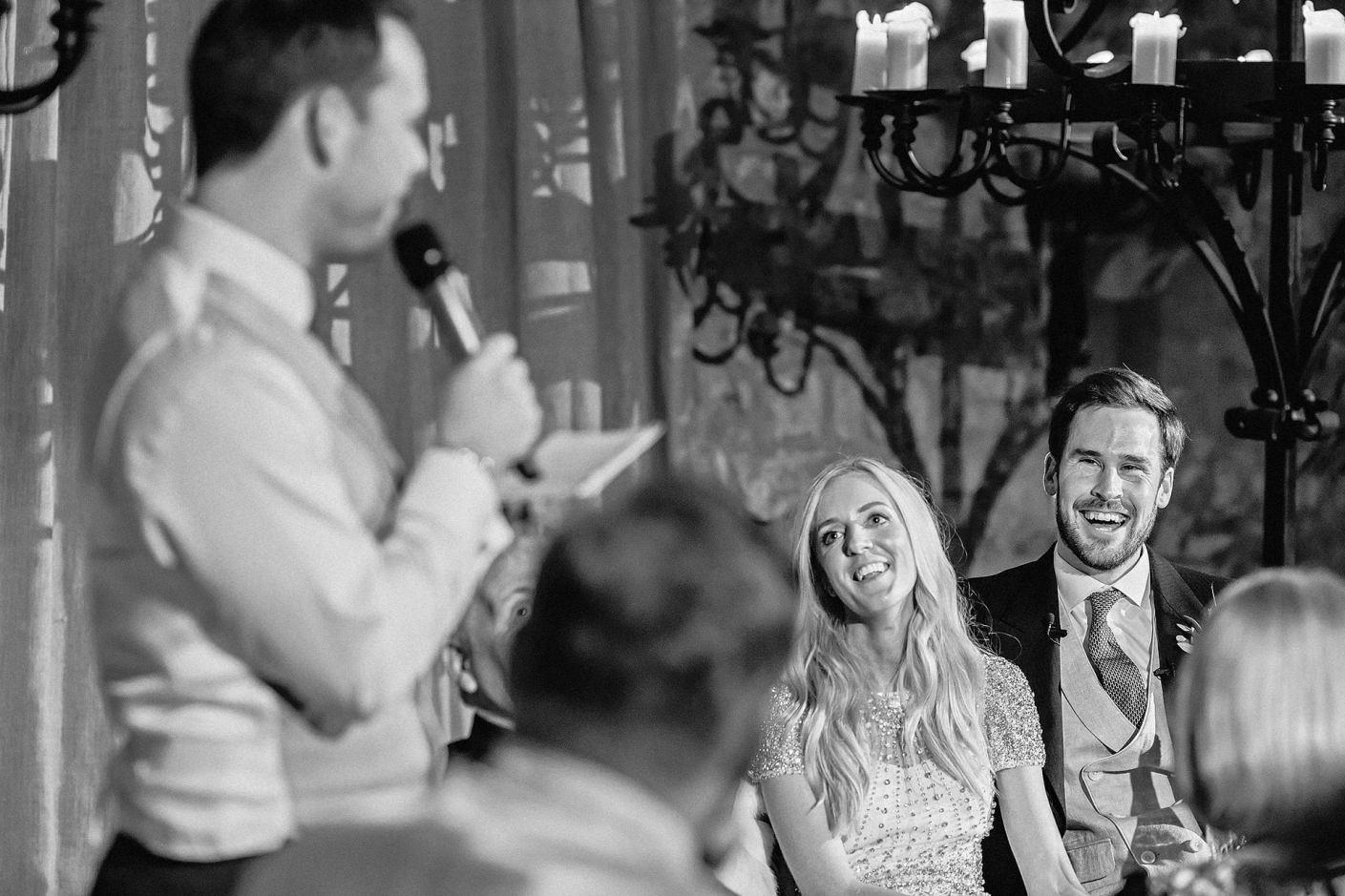 laughting during best man's speech