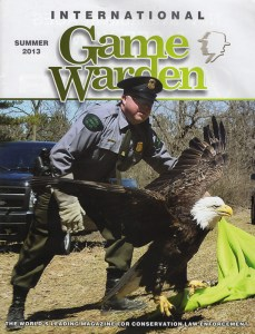 Issue of International Game Warden magazine with review of Badges, Bears, and Eagles by Steven T. Callan