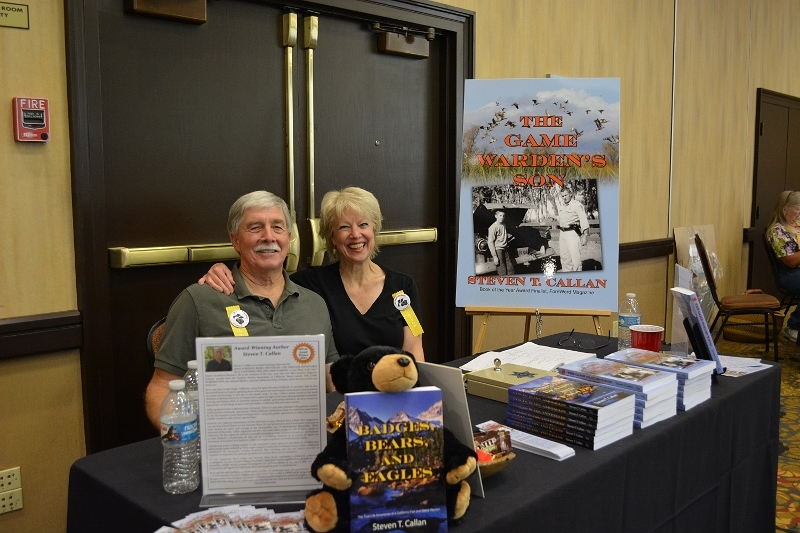 Author Steven T. Callan and Kathy Callan at a book signing for The Game Warden's Son at the Pacific Flyway Decoy Association Wildfowl Art Festival
