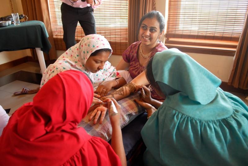Bhavya getting her mehendi done.