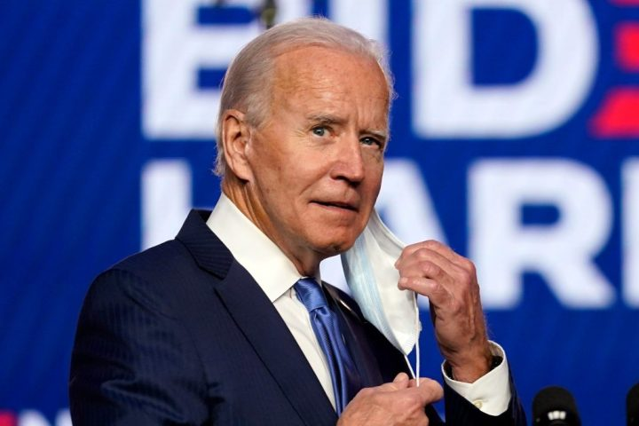 Biden clone with attached ear lobes. Who or what is pretending to be Joe Biden?