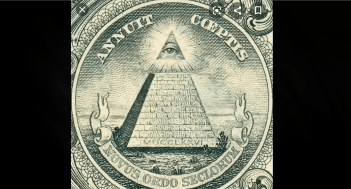 """Freemasonry symbolism """"ANNUIT COEPTIS NOVUS ORDO SECLORUM"""" is Latin and translates to """"A Plot to Undertake by oath, A NEW WORLD ORDER."""" Complete with the ALL-SEEING-EYE symbol, which is very common"""