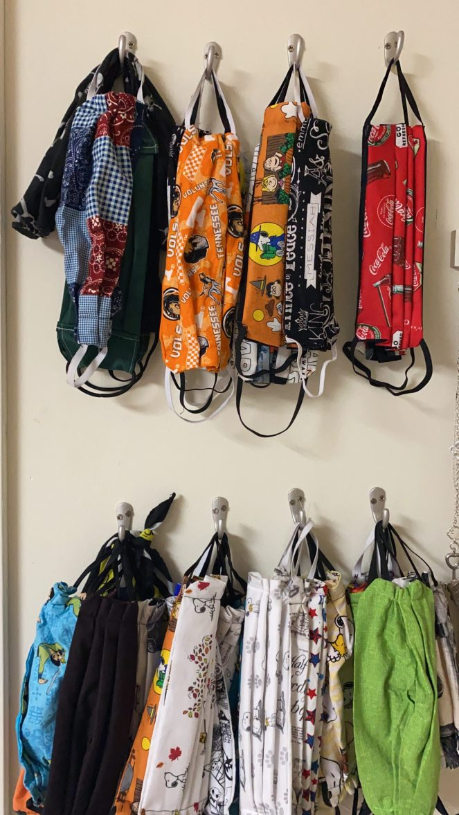 Hanging face masks - Here is how we hand up our face masks using hooks on the wall.