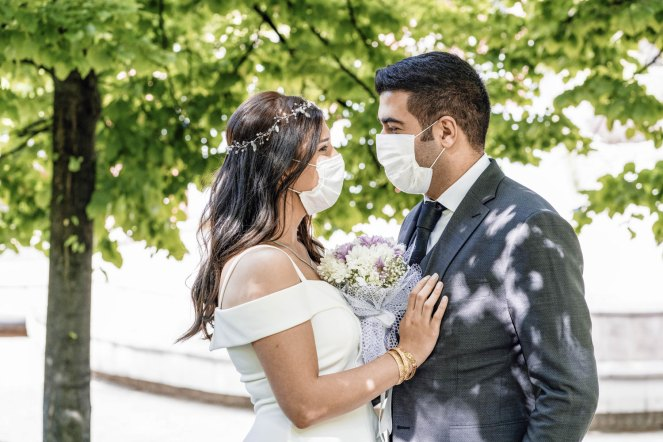 Precautions that could keep wedding guests safe during the pandemic - Couples planning to tie the knot in the months ahead can still do so, but the WHO recommends they take certain precautions as they organize their ceremonies and receptions. - Bride and Groom wearing face mask. Image Compliments of MetroCreative.