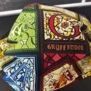 Harry Potter Houses Face Mask - a face mask with the sorting houses from Harry Potter. #HarryPotter