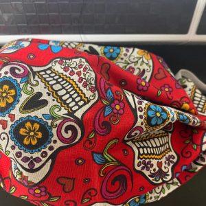 Red Sugar Skulls Face Mask - a red face mask with sugar skulls on it. #SugarSkulls #DayoftheDead