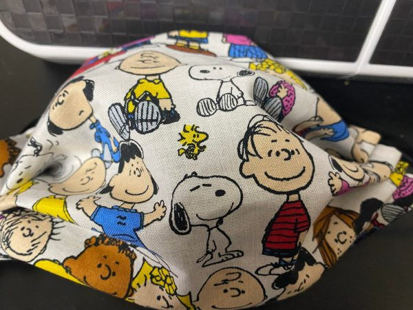 Snoopy and the Peanuts Gang Face Mask a great face mask with a good bit of the Peanuts gang. #Peanuts #Snoopy #CharlieBrown